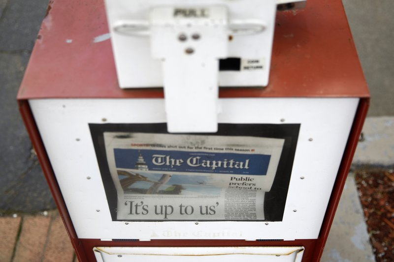 A copy of the day's Capital Gazette newspaper rests in a newsstand, Monday, April 15, 2019, in Annapolis, Md. (AP Photo/Patrick Semansky)