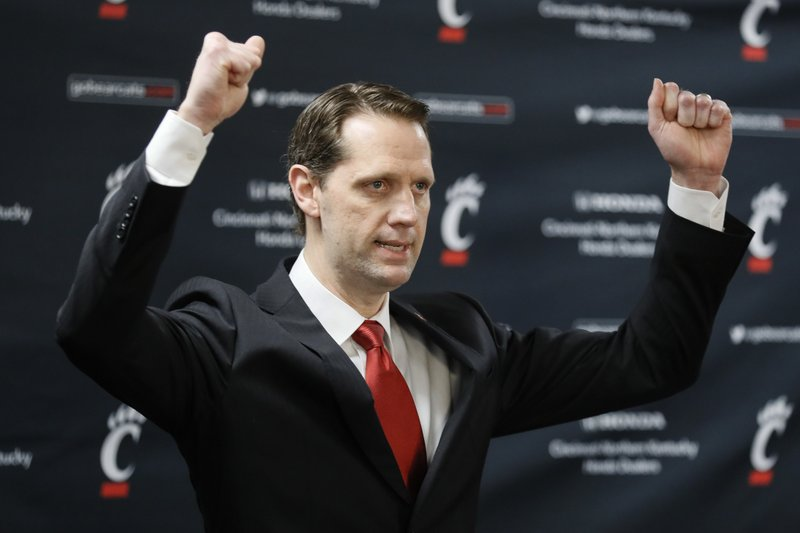 John Brannen gestures during a news conference to formally announce his hiring as Cincinnati's men's basketball coach, Monday, April 15, 2019, in Cincinnati. (AP Photo/John Minchillo)