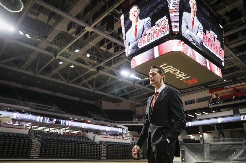 John Brannen walks the floor of Fifth Third Arena following a news conference to formally announce his hiring as Cincinnati's men's basketball coach after leading Northern Kentucky to two NCAA Tournament appearances in the last three years, Monday, April 15, 2019, in Cincinnati. (AP Photo/John Minchillo)