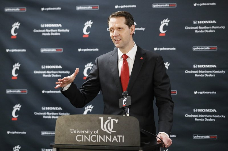John Brannen speaks during a news conference to formally announce his hiring as Cincinnati's men's basketball coach after leading Northern Kentucky to two NCAA Tournament appearances in the last three years, Monday, April 15, 2019, in Cincinnati. (AP Photo/John Minchillo)