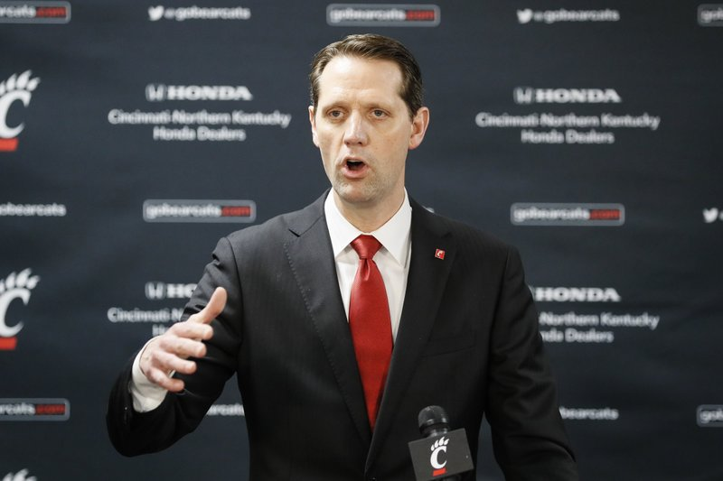 John Brannen speaks during a news conference to formally announce his hiring as Cincinnati's men's basketball coach  in Cincinnati, Monday, April 15, 2019. (AP Photo/John Minchillo)