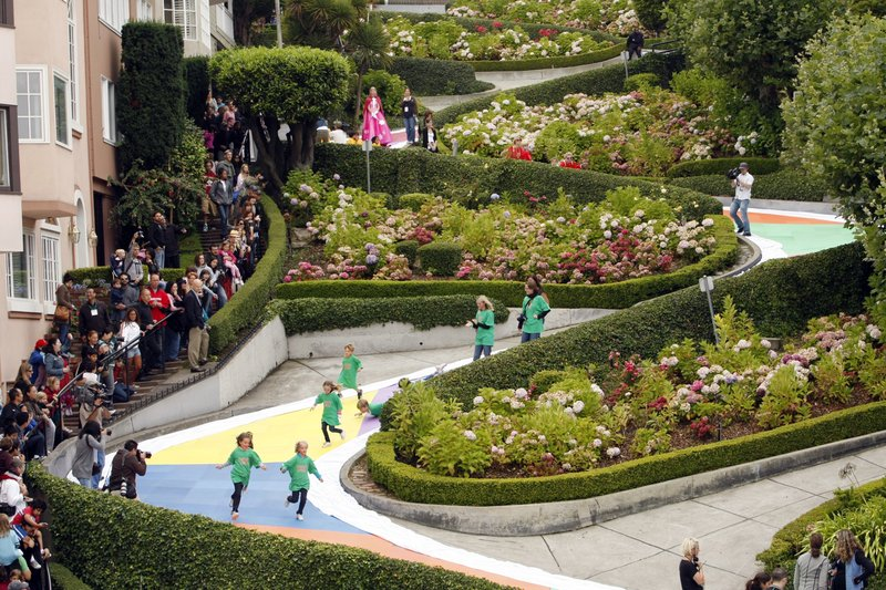 FILE - In this Aug. 19, 2009 file photo, children run down Lombard Street in San Francisco, transformed for the day into a gigantic Candy Land board game to commemorate the game's 60th anniversary. (AP Photo/Marcio Jose Sanchez, File)