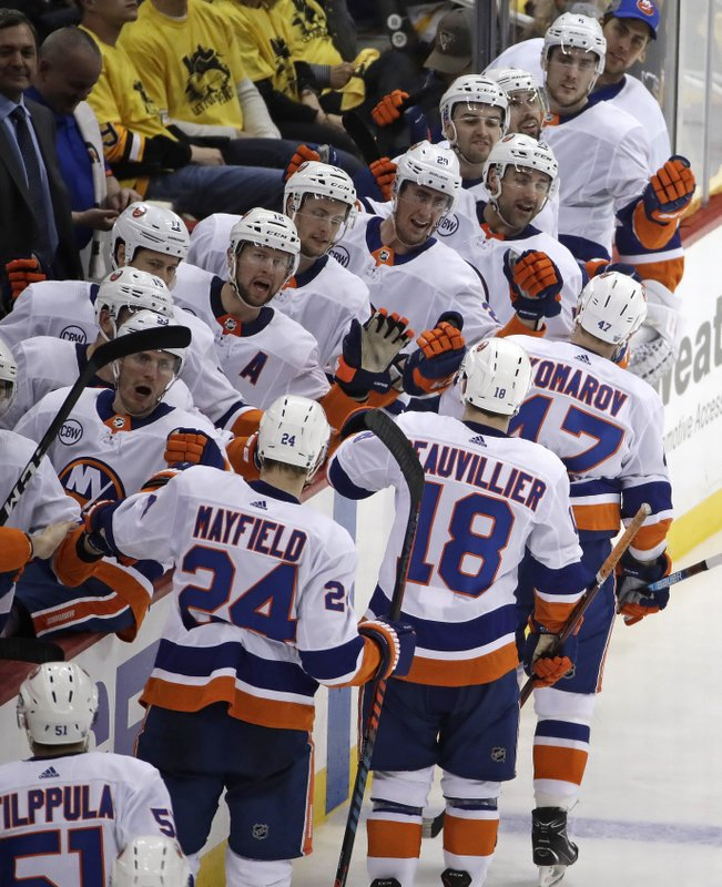 New York Islanders' Leo Komarov (47) leads the way back to the bench after his goal during the third period in Game 3 of an NHL first-round hockey playoff series against the Pittsburgh Penguins in Pittsburgh, Sunday, April 14, 2019. (AP Photo/Gene J. Puskar)