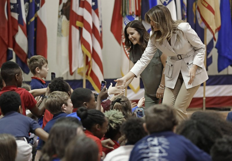 First lady Melania Trump, right, and second lady Karen Pence, left, greet student at Albritton Middle School in Fort Bragg, N. (AP Photo/Chuck Burton)