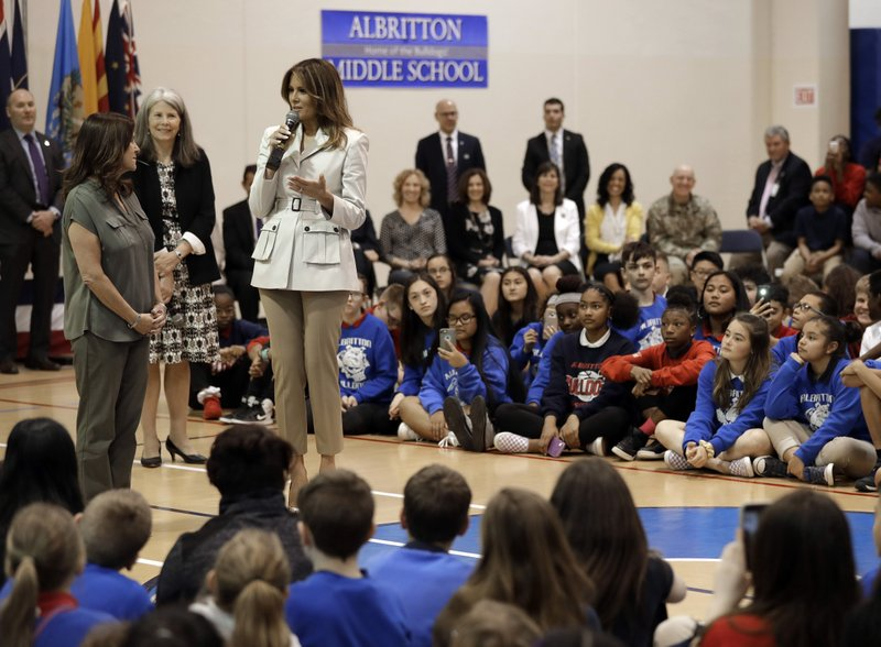 First lady Melania Trump, right, and second lady Karen Pence, left, speak to students at Albritton Middle School in Fort Bragg, N. (AP Photo/Chuck Burton)