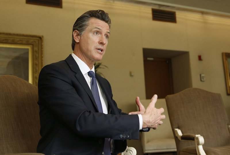 Gov. Gavin Newsom speaks during an interview with The Associated Press, Monday, April 15, 2019, in Sacramento, Calif. (AP Photo/Rich Pedroncelli)