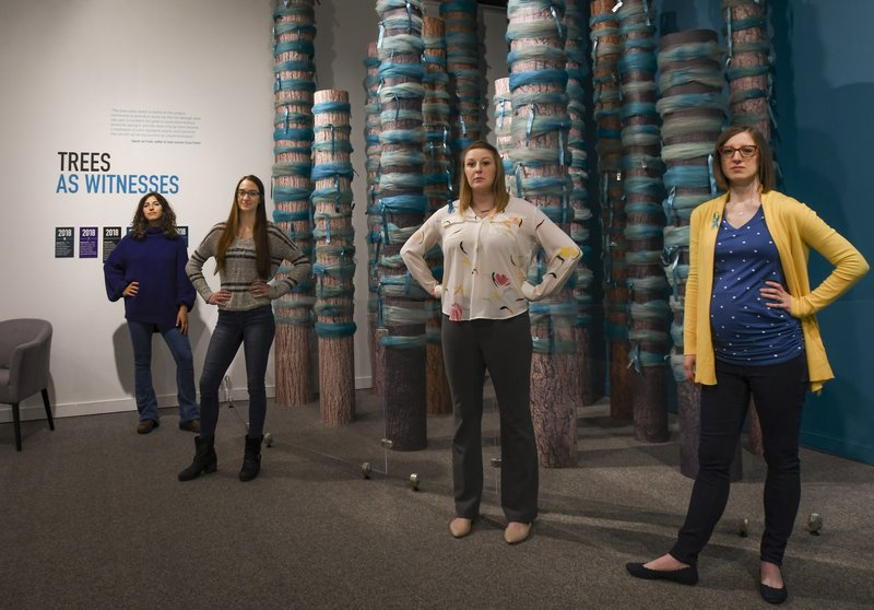 Curators of the 'Finding Our Voice: Sister Survivors Speak' exhibit, from left, Jordyn Fishman, Katie Black, Amanda Smith, and Melissa Hudecz pose for a photo in the MSU Museum's main gallery in East Lansing, Mich. (Matthew Dae Smith/Lansing State Journal via AP)
