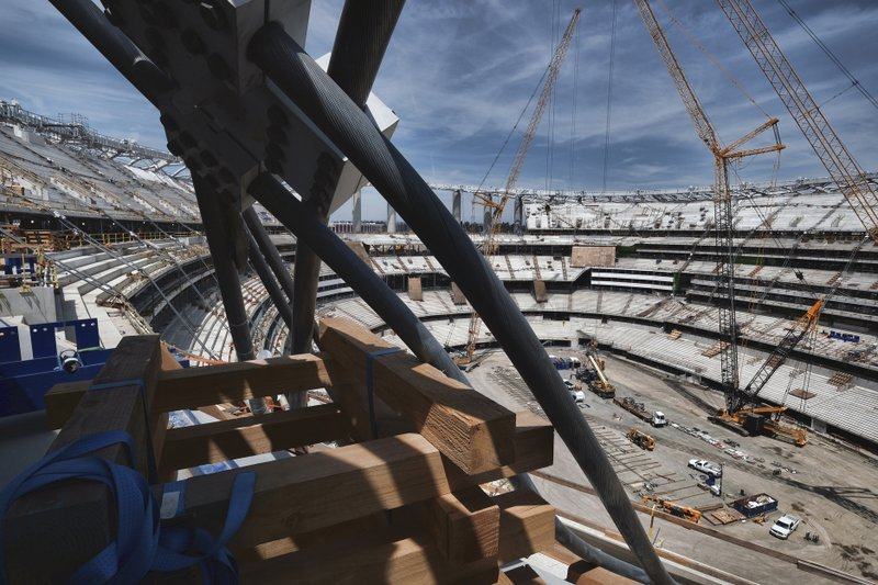 An arresting cable used for the canopy hangs over the side of the new NFL football Los Angeles Stadium under construction in Inglewood, Calif. (AP Photo/Richard Vogel)