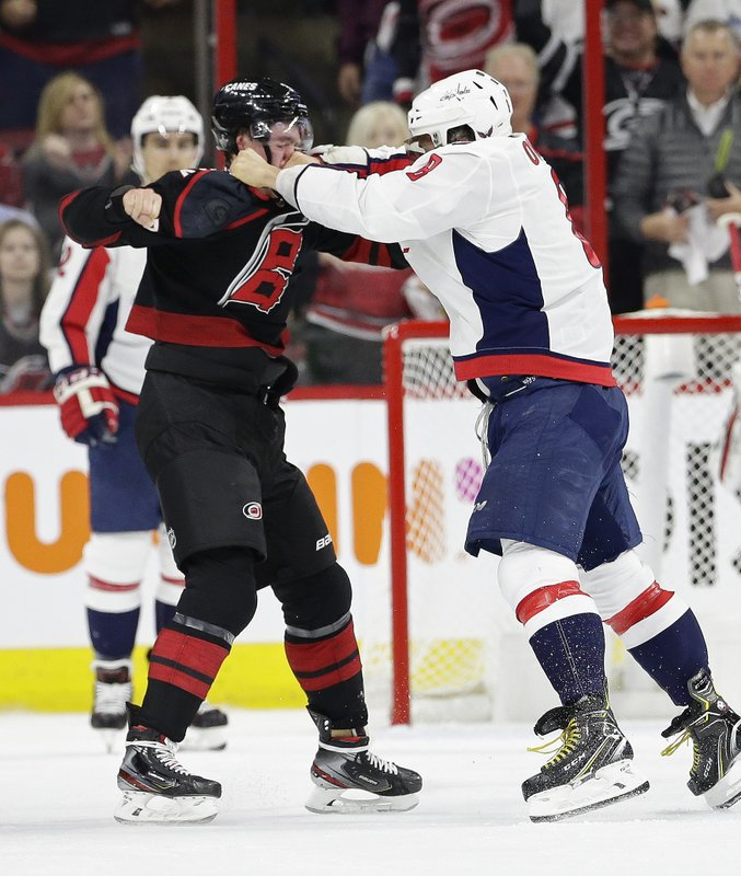 Washington Capitals' Alex Ovechkin, right, of Russia, punches Carolina Hurricanes' Andrei Svechnikov, also of Russia, during the first period of Game 3 of an NHL hockey first-round playoff series in Raleigh, N. (AP Photo/Gerry Broome)