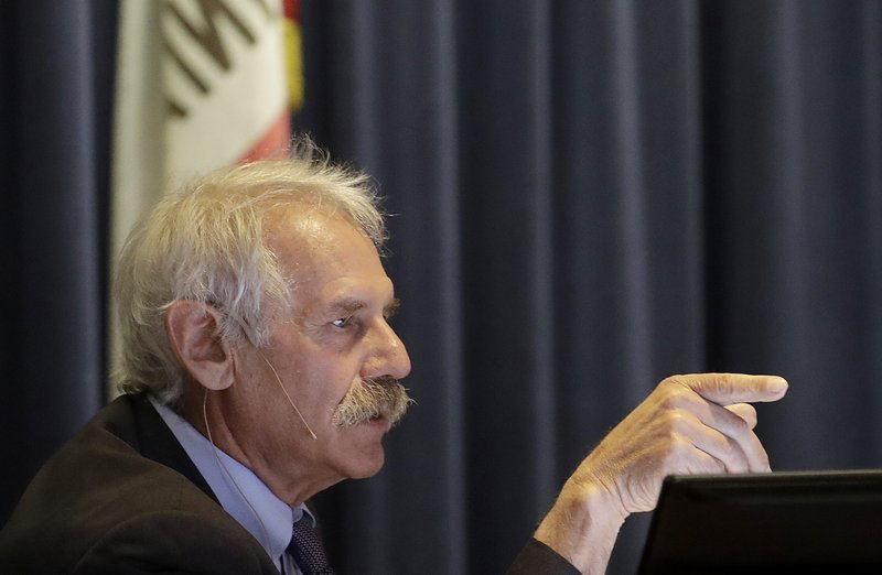 File - In this Jan. 28, 2019, file photo, Michael Picker, President of the California Public Utilities Commission, speaks during a meeting in San Francisco. (AP Photo/Jeff Chiu, File)
