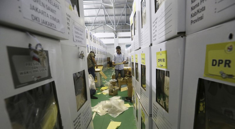 Workers prepare ballot boxes to be distributed to polling stations in Jakarta, Indonesia, Monday, April 15, 2019. (Achmad Ibrahim)