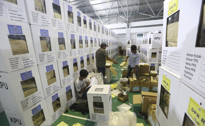 Workers prepare ballot boxes to be distributed to polling stations in Jakarta, Indonesia, Monday, April 15, 2019. (AP Photo/Achmad Ibrahim)