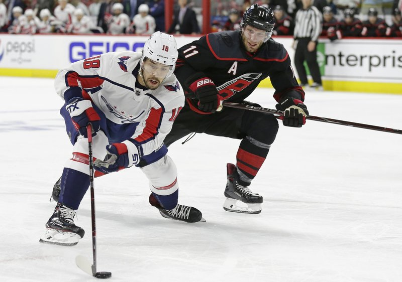 Carolina Hurricanes' Jordan Staal (11) defends against Washington Capitals' Chandler Stephenson (18) during the first period of Game 3 of an NHL hockey first-round playoff series in Raleigh, N. (AP Photo/Gerry Broome)