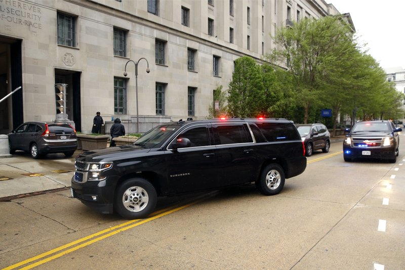 A motorcade carrying Attorney General William Barr arrives at the Department of Justice, Monday, April 15, 2019, in Washington. (AP Photo/Patrick Semansky)