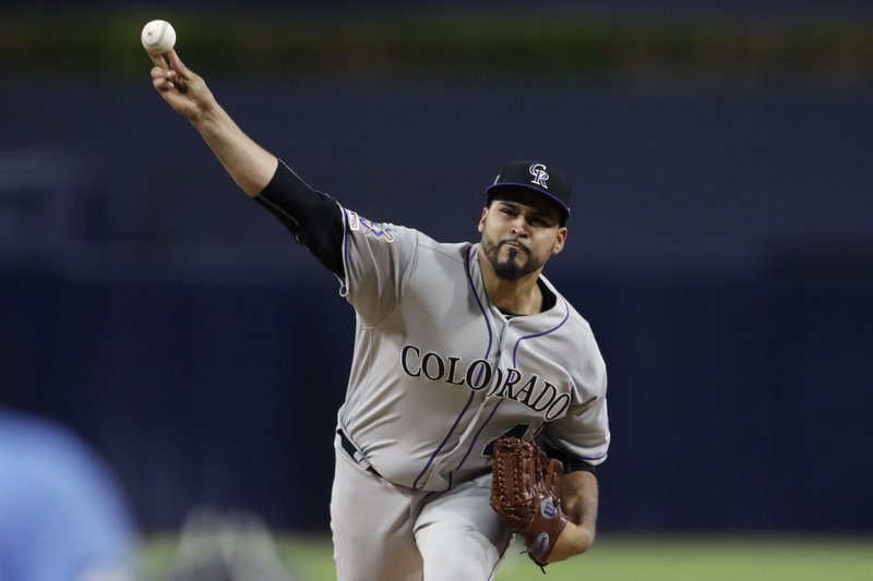 Colorado Rockies starting pitcher Antonio Senzatela works against a San Diego Padres batter during the first inning of a baseball game Monday, April 15, 2019, in San Diego. (AP Photo/Gregory Bull)