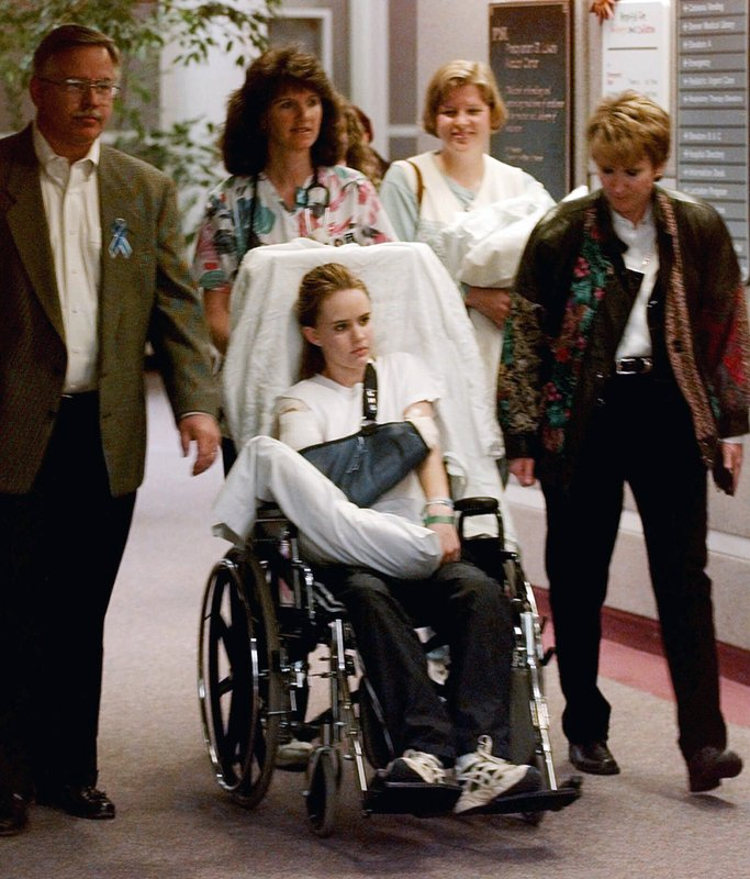 FILE - In this May 1, 1999, file photo, Kacey Ruegsegger, 17, is wheeled from a Denver hospital by Patty Anderson, center, after being released. (AP Photo/Ed Andrieski, File)