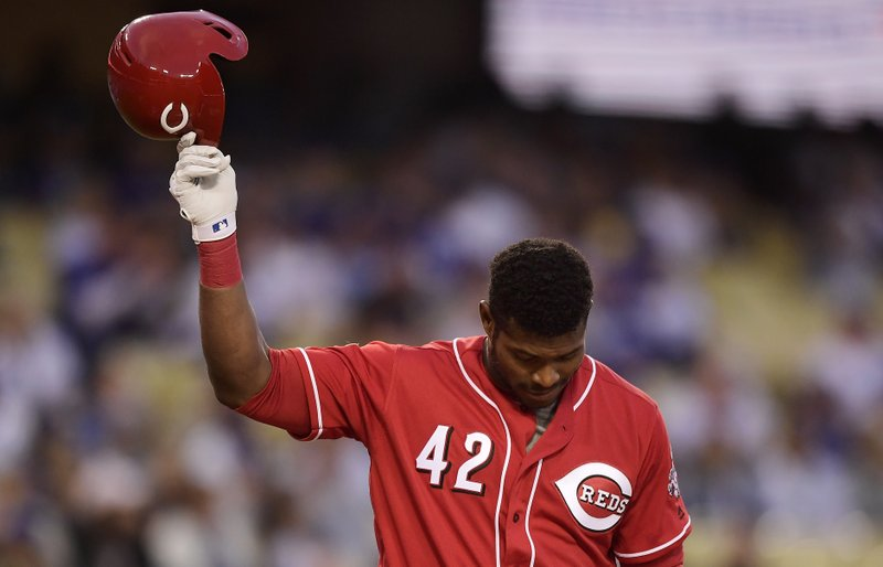 Cincinnati Reds' Yasiel Puig tips his helmet to fans as he comes up to bat during the first inning of a baseball game against the Los Angeles Dodgers, Monday, April 15, 2019, in Los Angeles. (AP Photo/Mark J. Terrill)