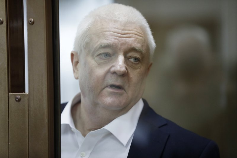 Norwegian national Frode Berg, who is accused of spying on Russia, stands inside a glass cage in a court room in Moscow, Russia, Tuesday, April 16, 2019. (AP Photo/Pavel Golovkin)