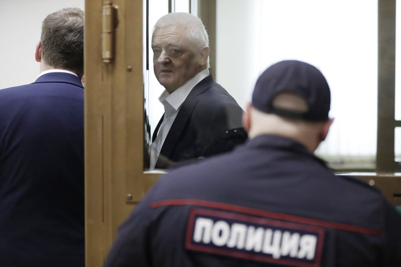 Norwegian national Frode Berg, who is accused of spying on Russia, speaks with his lawyer Ilya Novikov from inside a glass cage in a court room in Moscow, Russia, Tuesday, April 16, 2019. (AP Photo/Pavel Golovkin)