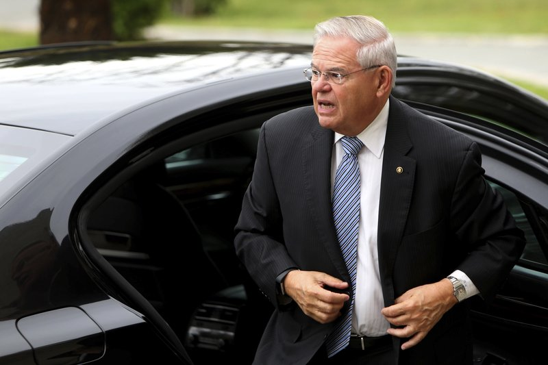 U.S. Senator Robert Menendez arrives at the presidential palace for a meeting with Cyprus' president Nicos Anastasiades in capital Nicosia, Cyprus, Tuesday, April 16, 2019. (AP Photo/Petros Karadjias)