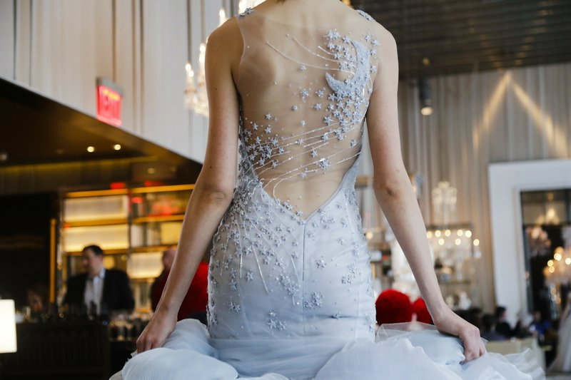 Fashion from the Ines Di Santo bridal collection is modeled Friday, April 12, 2019, in New York. (AP Photo/Frank Franklin II)