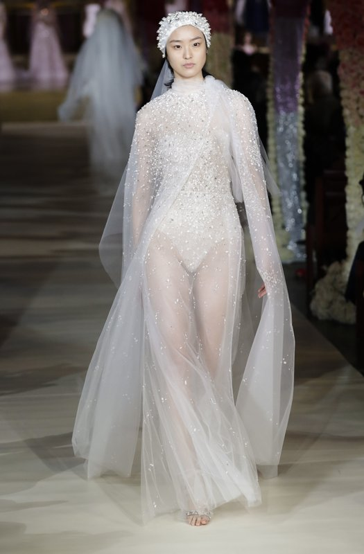 Fashion from the Reem Acra bridal collection is modeled Thursday, April 11, 2019, in New York. (AP Photo/Frank Franklin II)