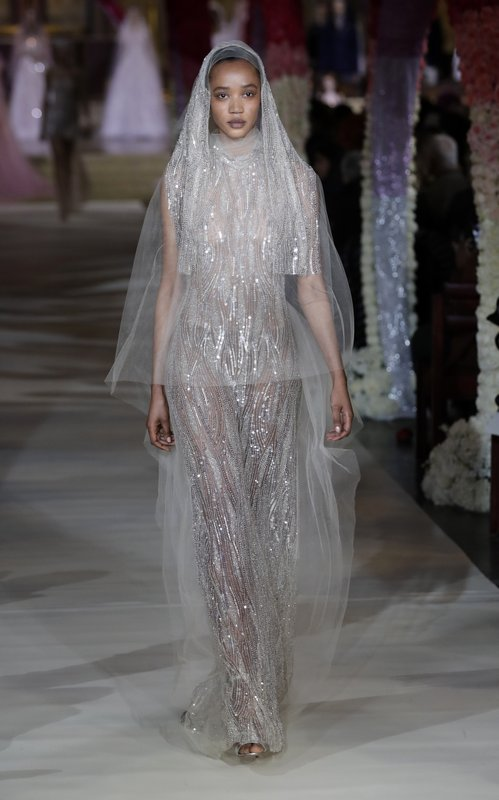 EDS NOTE: NUDITY - Fashion from the Reem Acra bridal collection is modeled Thursday, April 11, 2019, in New York. (AP Photo/Frank Franklin II)