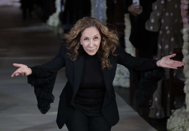 Fashion designer Reem Acra appears at her bridal collection fashion show Thursday, April 11, 2019, in New York. (AP Photo/Frank Franklin II)