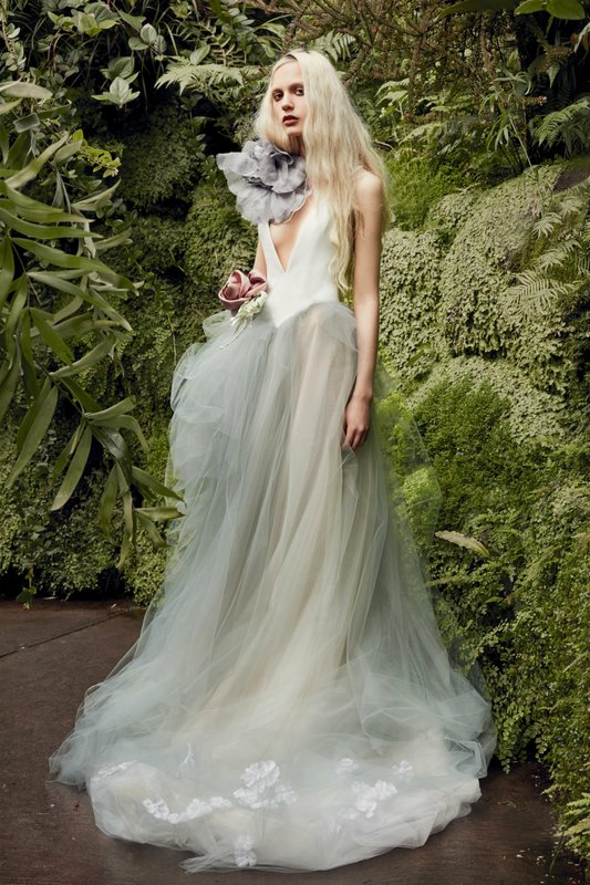 This image released by Vera Wang shows a gown from her bridal collection being modeled in New York. (Vera Wang via AP)