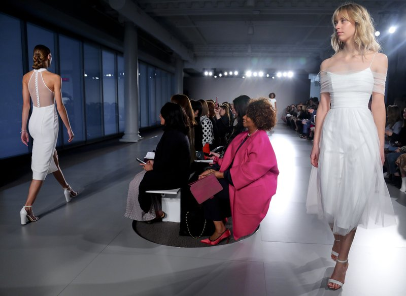 Fashion from the Amsale bridal collection is modeled, Friday April 12, 2019 in New York. (AP Photo/Bebeto Matthews)