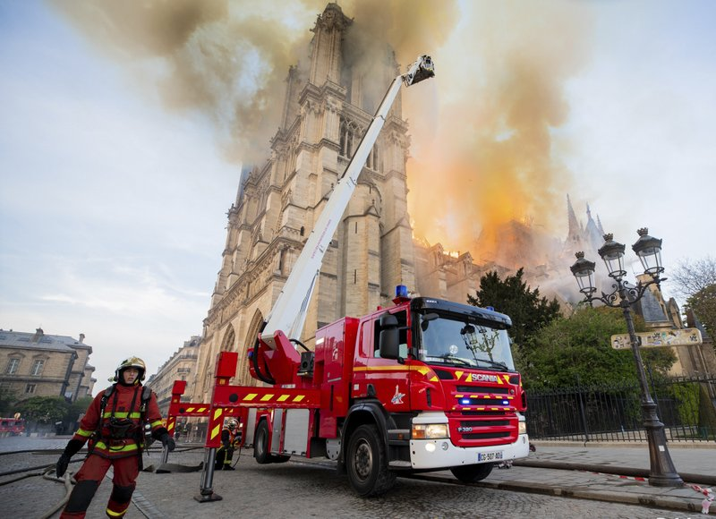 This photo provided on Tuesday April 16, 2019 by the Paris Fire Brigade shows fire fighters working at the burning Notre Dame cathedral, Monday April 15, 2019. (Benoit Moser, BSPP via AP)