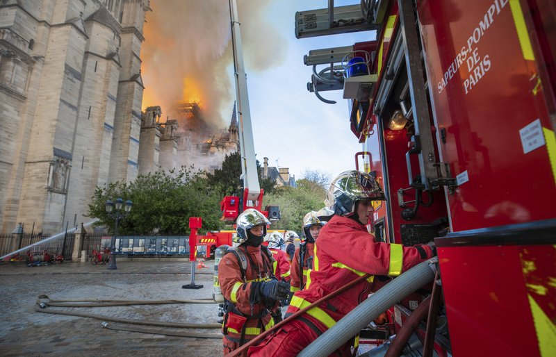 This photo provided Tuesday April 16, 2019 by the Paris Fire Brigade, shows fire fighters working at the burning Notre Dame cathedral, Monday April 15, 2019. (Benoit Moser, BSPP via AP)
