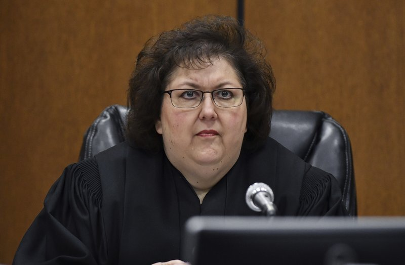 Judge Margaret Van Houten listens to Assistant Wayne County Prosecutor Matthew Penney deliver his opening remarks during the trial of former Michigan state trooper Mark Bessner, Wednesday, April 10, 2019, Detroit. (Clarence Tabb Jr./Detroit News via AP)