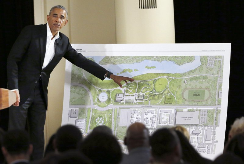 FILE - In this May 3, 2017, file photo, former President Barack Obama speaks near a rendering for the former president's lakefront presidential center at a community event on the Presidential Center at the South Shore Cultural Center in Chicago. (AP Photo/Nam Y. Huh, File)