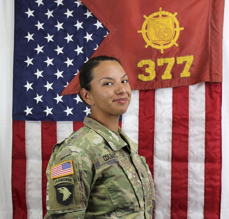 In this undated photo provided by the Fort Bliss, Texas, Public Affairs Office, shows Staff Sgt. Amy Colbert who's husband Sgt. (Fort Bliss Public Affairs Office via AP)