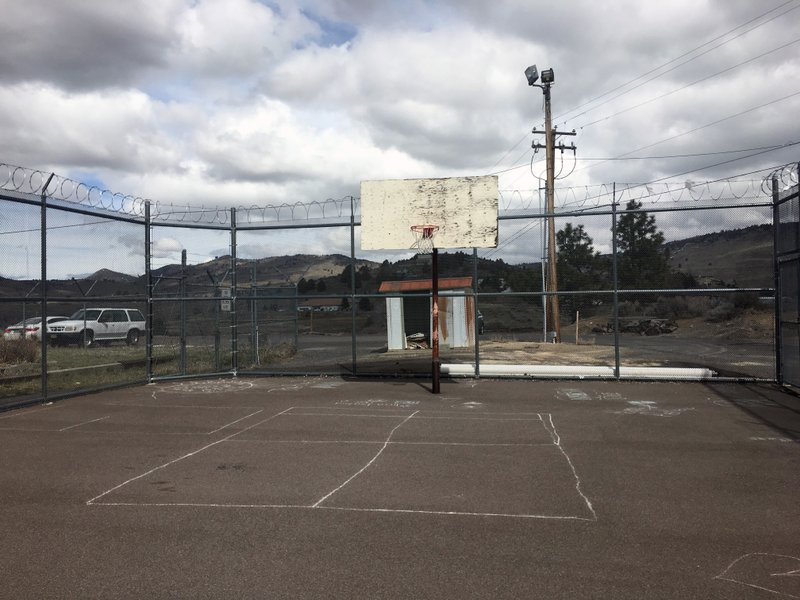 This undated photo provided by A Better Childhood, shows a barbed-wire enclosed exercise yard at the Youth Inspiration Program in Klamath Falls, Ore. (A Better Childhood via AP)