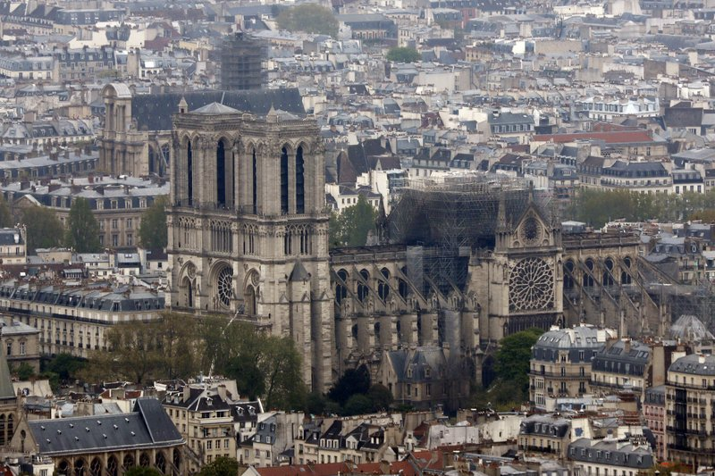 Notre Dame cathedral is pictured from the top of the Montparnasse tower, Tuesday April 16, 2019 in Paris. (AP Photo/Thibault Camus)