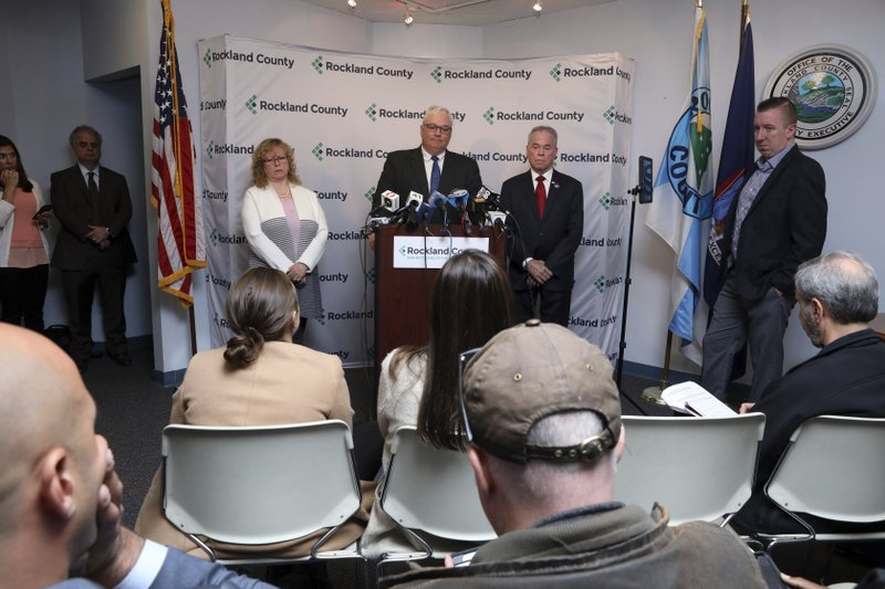 Attorney Thomas Humbach, center, speaks, as County Executive Ed Day, right, and Rockland County Commissioner of Health Dr. (Tania Savayan/The Journal News via AP)