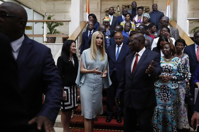 White House senior adviser Ivanka Trump, center left, talks with Ivory Coast Vice President Daniel Kablan Duncan, center right, at the end of a group photo with officials at the Presidential Palace, Tuesday April 16, 2019, in Abidjan, Ivory Coast. (AP Photo/Jacquelyn Martin)