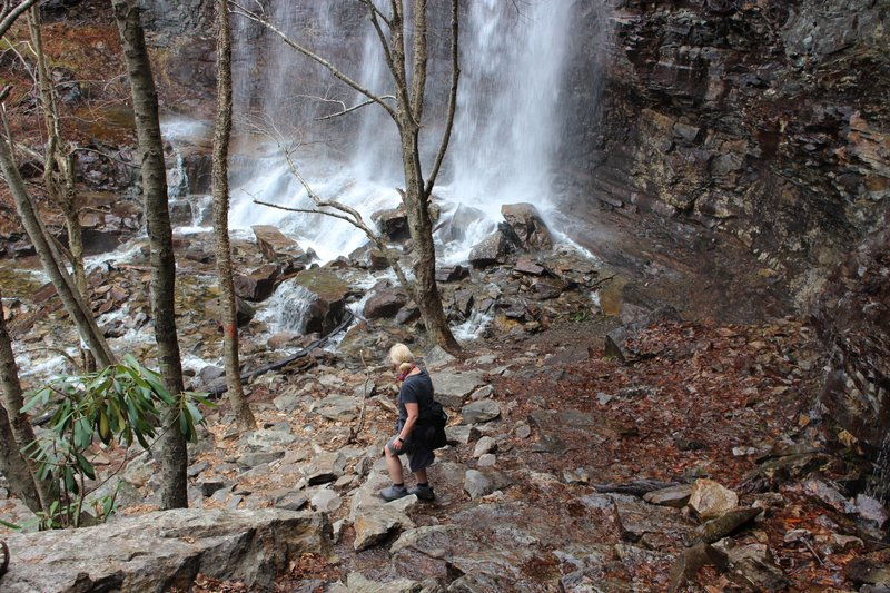An unidentified woman makes her way to the base of the waterfalls just off the Glen Onoko Falls Trail in Jim Thorpe, Pa. (AP Photo/Michael Rubinkam)