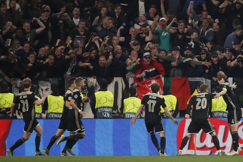 Ajax's Matthijs de Ligt, right, celebrates after scoring his side's second goal during the Champions League quarter final, second leg soccer match between Juventus and Ajax, at the Allianz stadium in Turin, Italy, Tuesday, April 16, 2019. (AP Photo/Antonio Calanni)