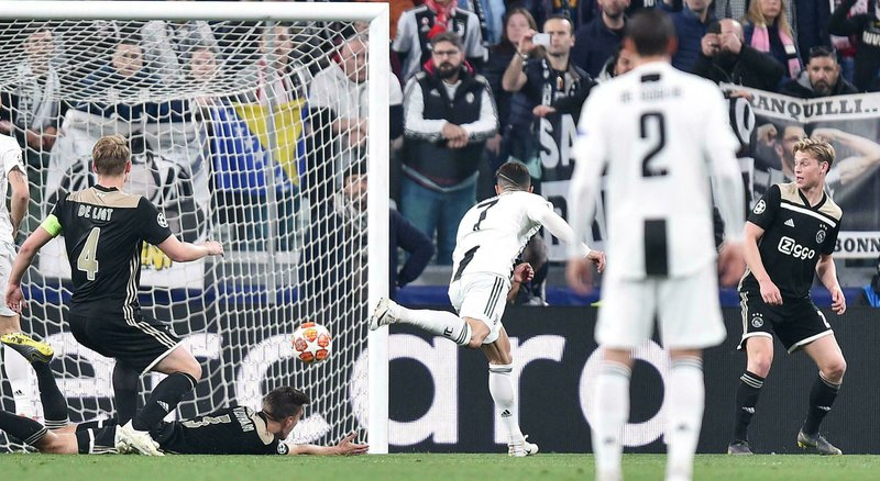 Juventus' Cristiano Ronaldo scores his side's opening goal during the Champions League, quarterfinal, second leg soccer match between Juventus and Ajax, at the Allianz stadium in Turin, Italy, Tuesday, April 16, 2019. (Alessandro Di Marco/ANSA via AP)