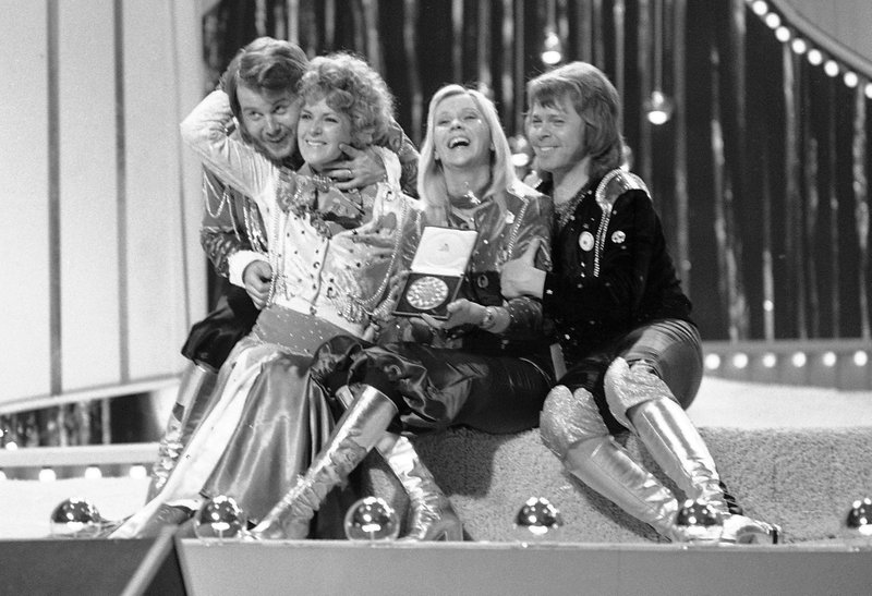 """FILE - In this April 6, 1974 file photo, Swedish pop group ABBA celebrate winning the 1974 Eurovision Song Contest on stage at the Brighton Dome in England. (Frida), Agnetha Faltskog, and Bjorn Ulvaeus. In their song """"One Last Summer,"""" they write the sentimental detail, """"In the tourist jam, round the Notre-Dame/Our last summer/Walking hand in hand."""