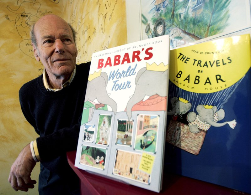 FILE - In this Friday, April 21, 2006 file photo, Babar author Laurent de Brunhoff poses for a photograph at Mabel's Fables bookstore in Toronto, Ontario, Canada. (Nathan Denette/The Canadian Press via AP)