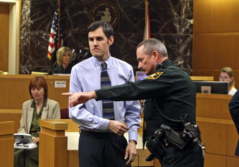 Defendant John Jonchuck is directed by a Pinellas County Sheriff deputy to the finger print area after a jury found him guilty, Tuesday, April 16, 2019, Clearwater, Fla. (Scott Keeler/Tampa Bay Times via AP, Pool)