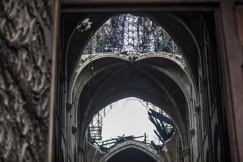 Holes seen in the dome inside the damaged Notre Dame cathedral in Paris, Tuesday, April 16, 2019. Firefighters declared success Tuesday in a more than 12-hour battle to extinguish an inferno engulfing Paris' iconic Notre Dame cathedral that claimed its spire and roof, but spared its bell towers and the purported Crown of Christ. (Christophe Petit Tesson, Pool via AP)