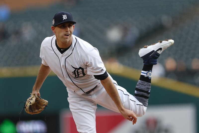 Detroit Tigers pitcher Matthew Boyd watches a delivery to the Pittsburgh Pirates during the first inning of a baseball game in Detroit, Tuesday, April 16, 2019. (AP Photo/Paul Sancya)