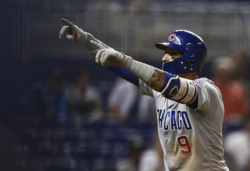 Chicago Cubs' Javier Baez (9) celebrates after hitting a solo home run off Miami Marlins pitcher Adam Conley during the eighth inning of a baseball game, Tuesday, April 16, 2019, in Miami. (AP Photo/Brynn Anderson)