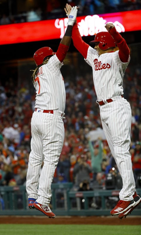 Philadelphia Phillies' Maikel Franco, left, and Aaron Altherr celebrate after Franco's three-run home run off New York Mets starting pitcher Steven Matz during the first inning of a baseball game, Tuesday, April 16, 2019, in Philadelphia. (AP Photo/Matt Slocum)