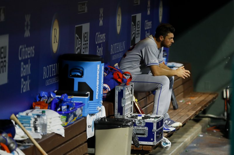 New York Mets starting pitcher Steven Matz sits in the dugout after being pulled during the first inning of a baseball game against the Philadelphia Phillies, Tuesday, April 16, 2019, in Philadelphia. (AP Photo/Matt Slocum)
